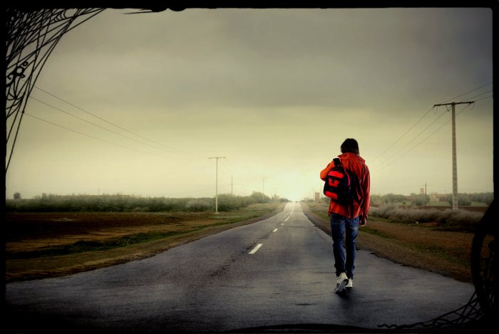 Young-man-walking-on-a-country-13798088
